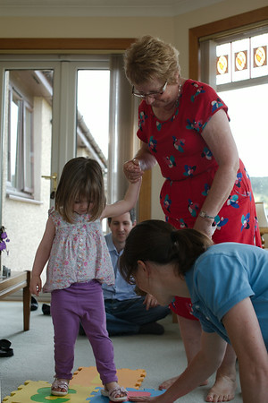 Granny Joan teaching Imogen how to play Hopscotch